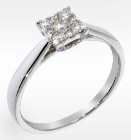 flott Diamantring i hvittgull med detaljer på sidene